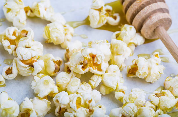 Sweet popcorn in honey stock photo