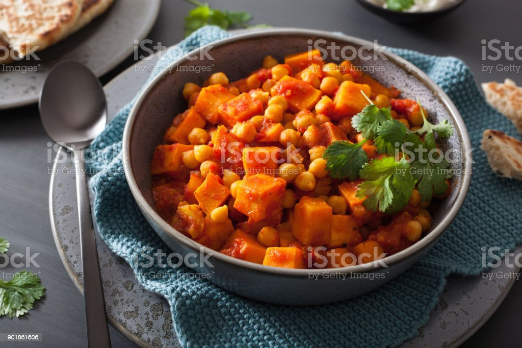 sweet potato and chickpea curry with naan bread stock photo