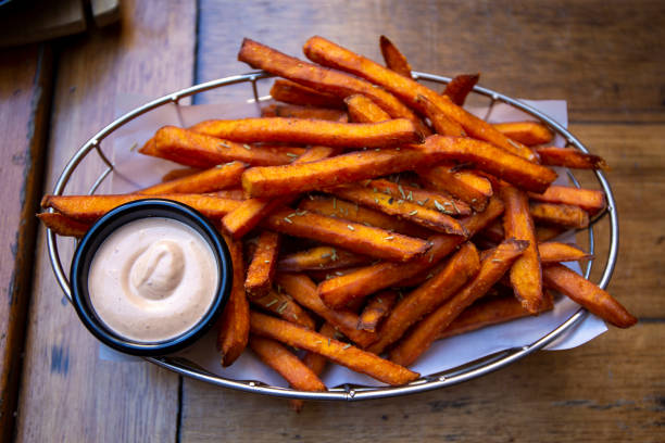 sweet potato fries Sweet Potato Fries with dipping sauces sweet potato stock pictures, royalty-free photos & images