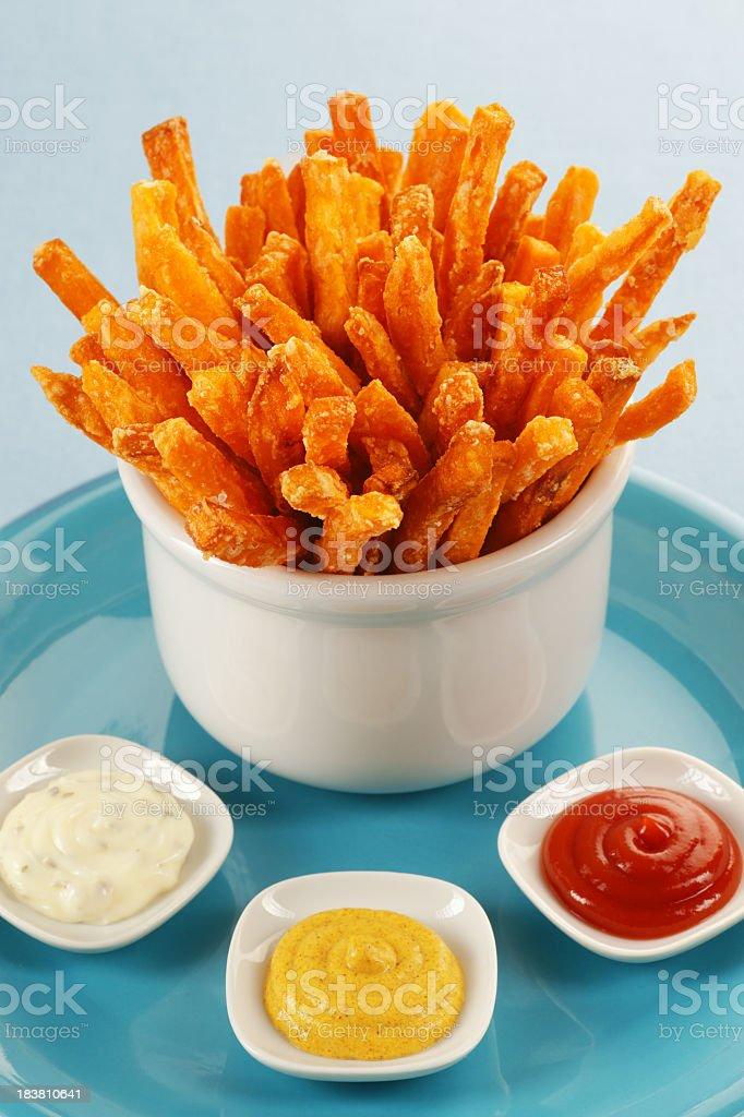 Sweet potato fries with mayonnaise, mustard and ketchup dips royalty-free stock photo