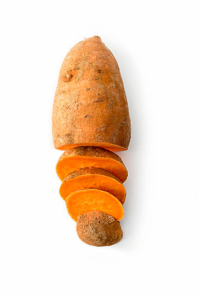 Sweet potato isolated on white studio background High angle view of one sweet potato, half sliced up. sweet potato stock pictures, royalty-free photos & images