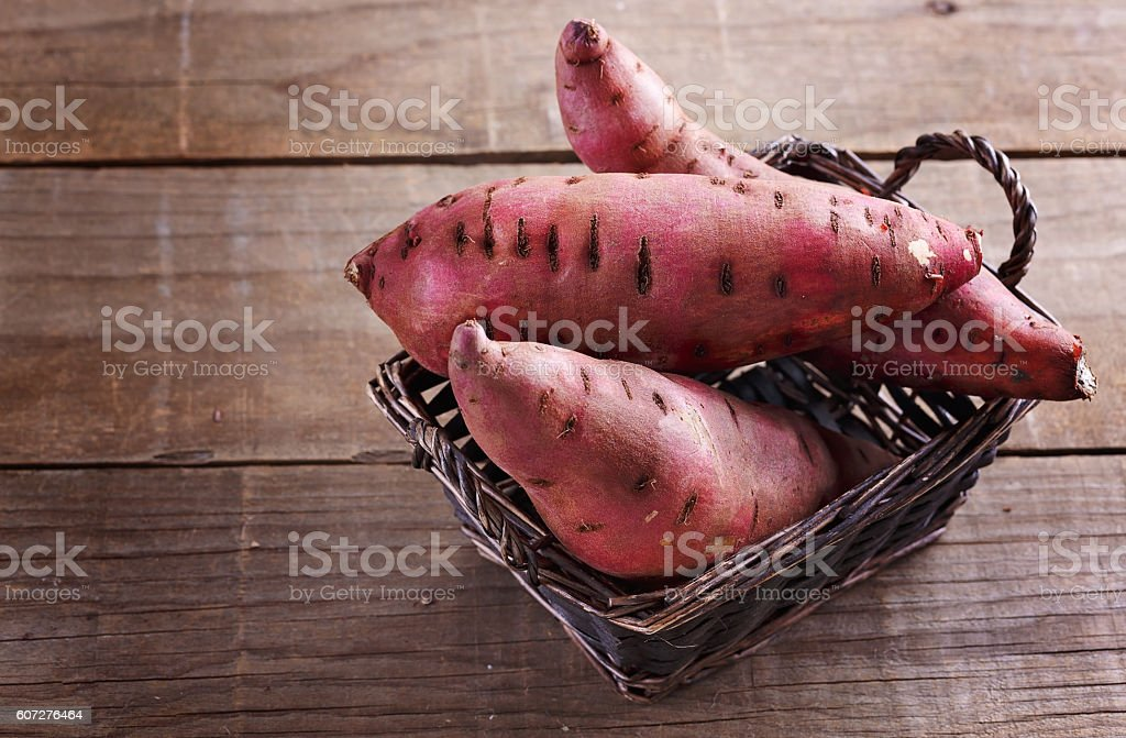 Sweet potato over rustic wooden background stock photo