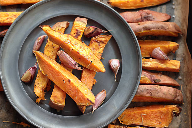 Sweet potato roasted chips. stock photo