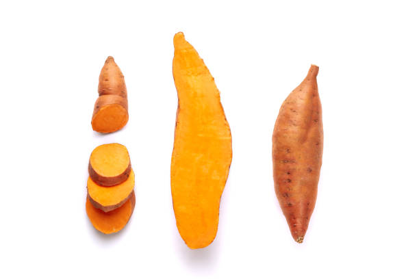 Sweet Potato Root Tuber, Peeled and Sliced Pieces Beauregard Sweet Potato Root Tuber, Peeled and Sliced Pieces Clipping Path. Vitamin Uncooked Orange Batata Isolated on White Background. Farmland Product Appreciated to Make Cakes or to Eat Roasted sweet potato stock pictures, royalty-free photos & images