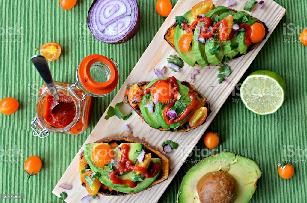 Sweet potato toasts with avocado stock photo