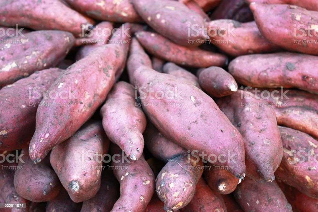 Sweet potatoes at the weekly market, Italy stock photo