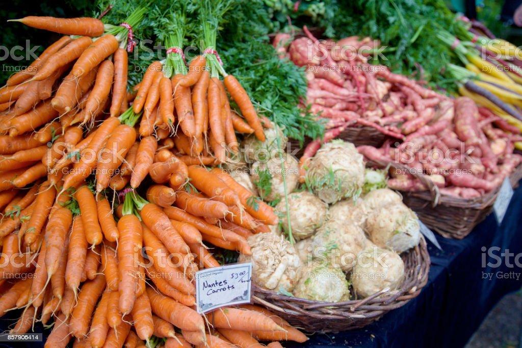 sweet potatoes, carrots and celeriac at the farmer's market stock photo