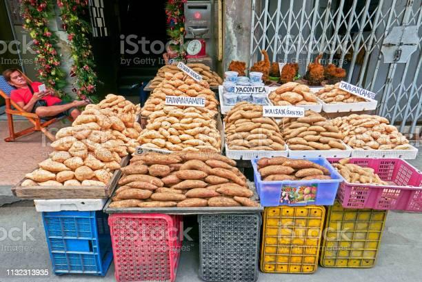 Sweet potatoes in baskets for sale along a street in manila picture id1132313935?b=1&k=6&m=1132313935&s=612x612&h=ruvynoec3bax6btssrhiikeavqeuejzzyxqqwi4h8ky=
