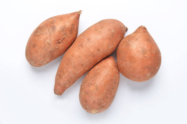 Sweet potatoes Ipomoea batatas shot from directly above on white background Sweet potatoes Ipomoea batatas shot from directly above on white background sweet potato stock pictures, royalty-free photos & images