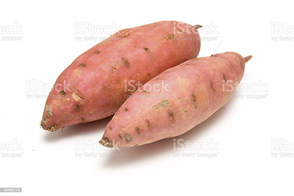Sweet potatoes on a white studio background. royalty-free stock photo