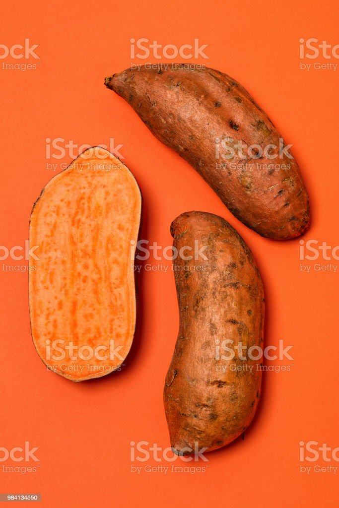 Sweet Potatoes on Orange - fotografia de stock