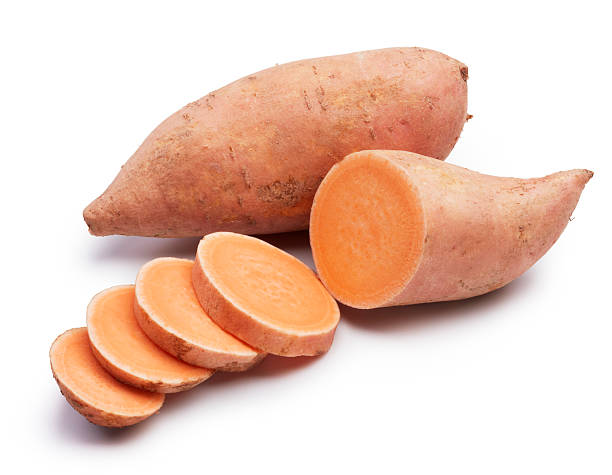 sweet potatoes sweet potatoes with slices isolated on white sweet potato stock pictures, royalty-free photos & images