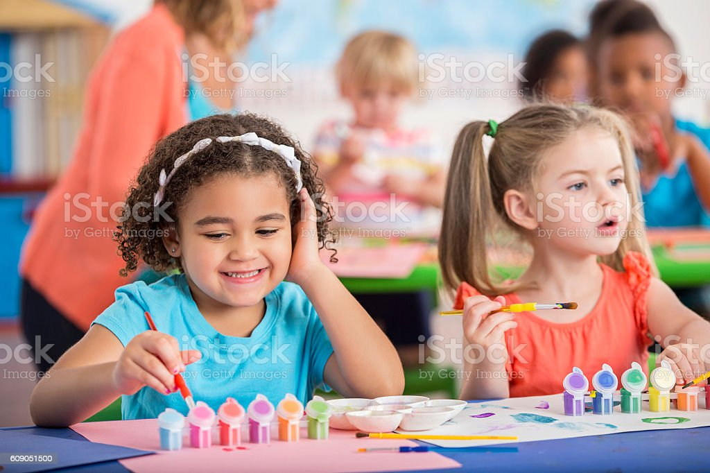 Sweet preschool friends have fun painting - Photo