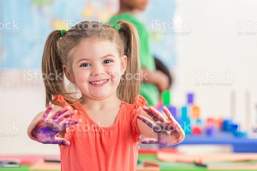 Sweet preschooler has fun with finger paints - Photo