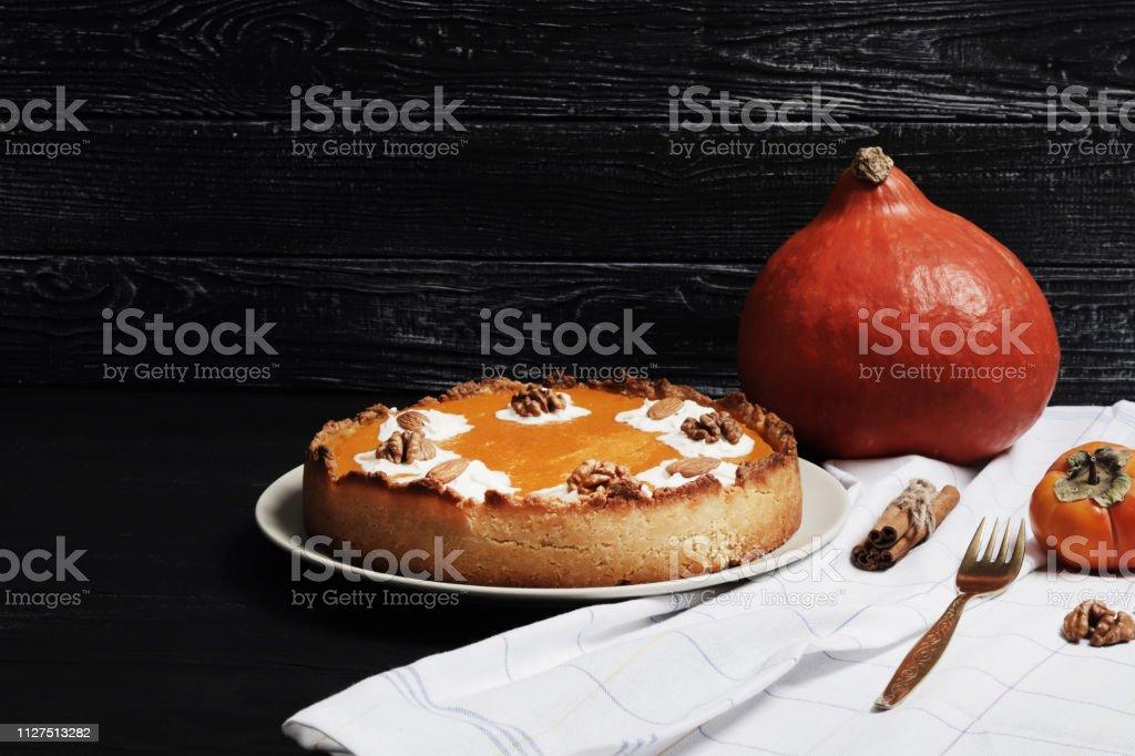 Sweet pumpkin cream pie. Pie with nuts. Harvest Pumpkin pie on a...