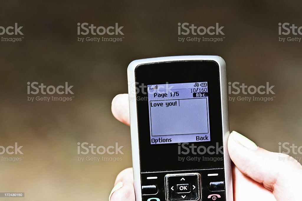 "Sweet ""Love you!"" message on screen of cell phone royalty-free stock photo"