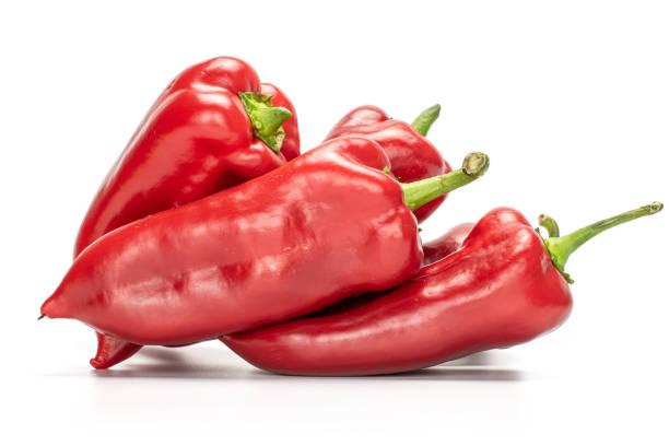 sweet red bell pepper isolated on white - red bell pepper isolated imagens e fotografias de stock