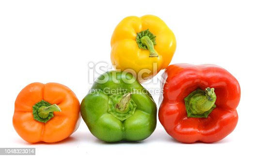 sweet red, orange, green, and yellow peppers isolated on white background