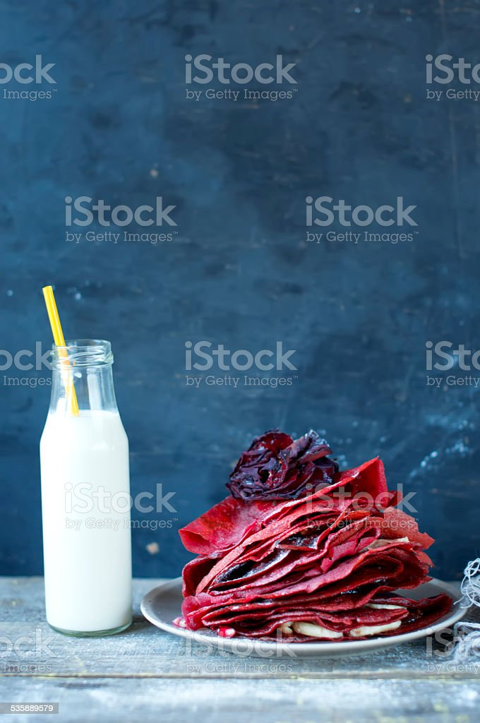 Sweet red pancakes and bottle of milk stock photo