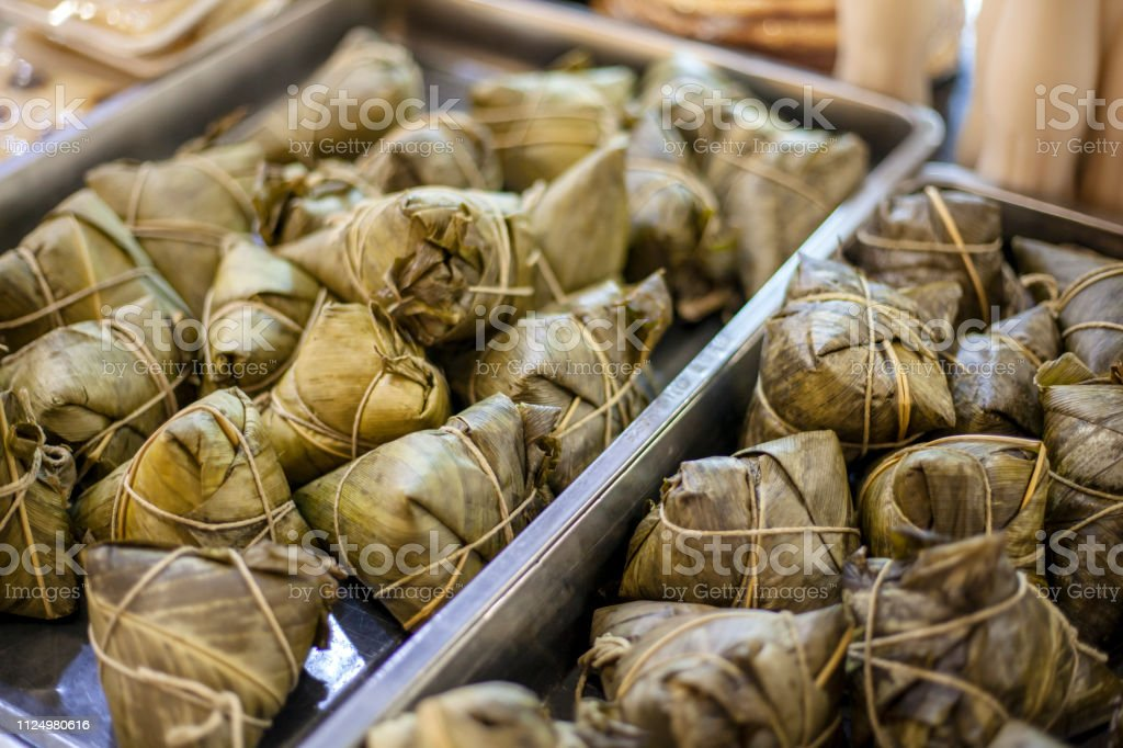 sweet rice in palm leaves, Ketupat or rice dumpling. stock photo