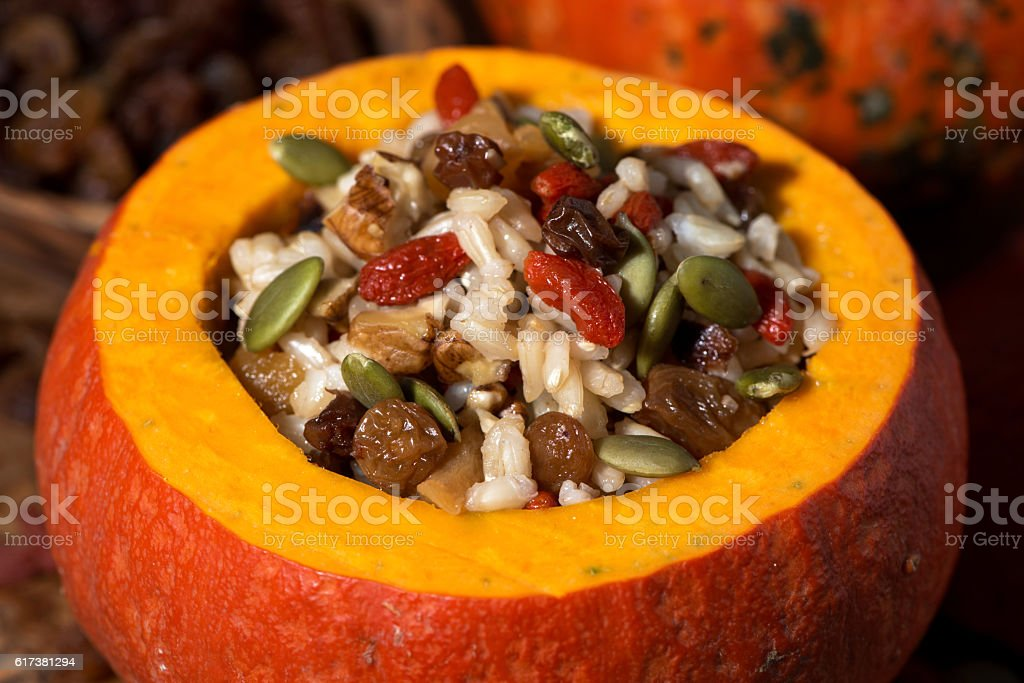 sweet rice with dried fruit in a pumpkin, closeup stock photo