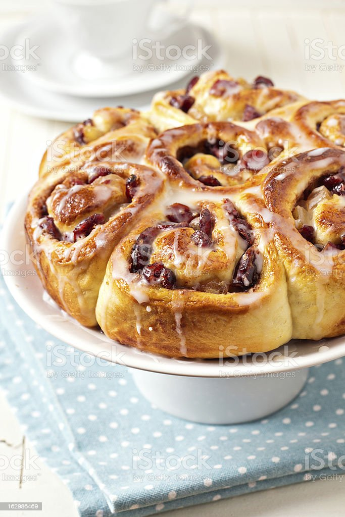 Sweet rolls with dried fruits and dripping glaze royalty-free stock photo