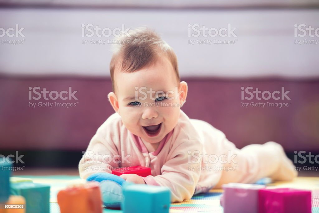 Sweet Smiling Baby Boy Crawling And Playing With Toys - Royalty-free Baby - Human Age Stock Photo