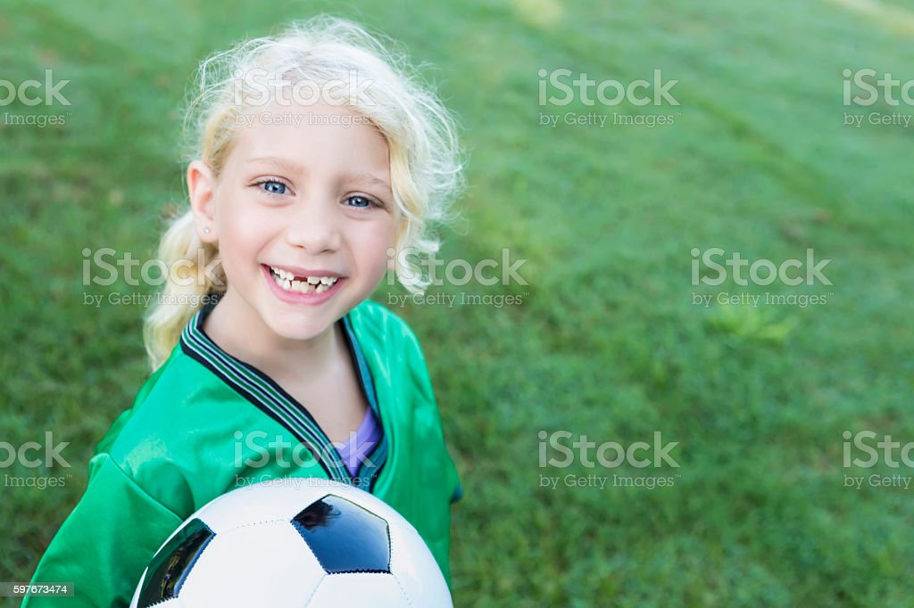 Sweet soccer girl with missing teeth stock photo