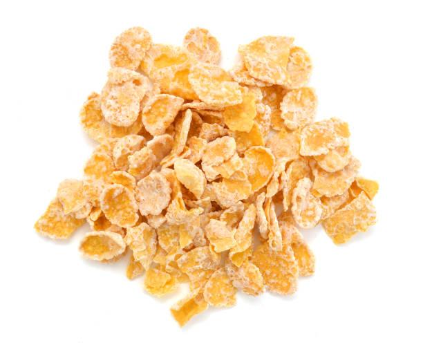copos de maíz dulce, sabrosos, seco crujiente en blanco, foto de alimentos - corn flakes fotografías e imágenes de stock