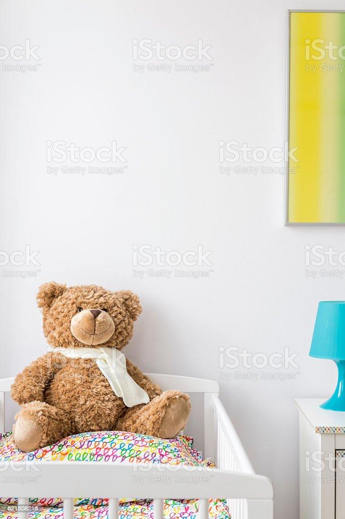 Sweet teddy bear in a cradle photo libre de droits
