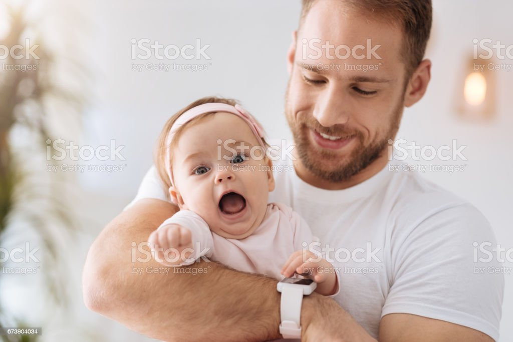 Sweet toddler girl having fun with her father stock photo