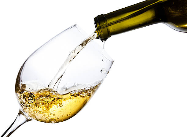 sweet wine isolated  on white background sweet  wine being poured into a wineglass, isolated  on white background white wine stock pictures, royalty-free photos & images