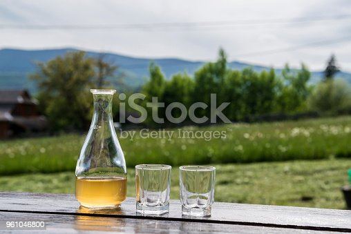 Sweet yellow honey wine meade in beautiful mountain landscape. Ready to drink