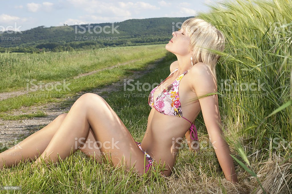 Sweet young blonde enjoy the sun royalty-free stock photo