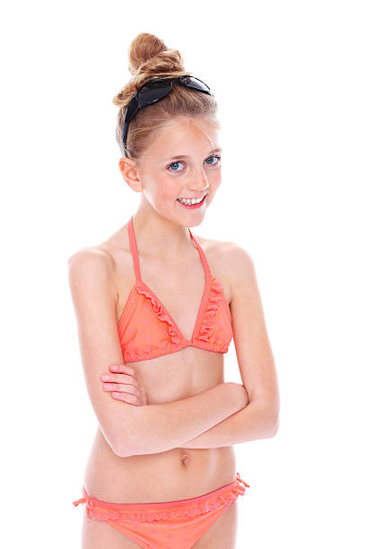Royalty free 14 year old girls in bikinis pictures images and stock photos istock - Teen age girl picthar ...