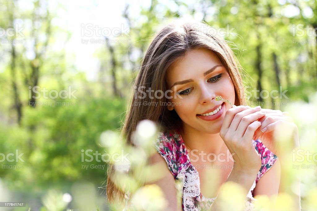 Sweet young woman lying in meadow on warm summer day royalty-free stock photo