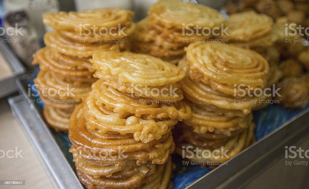 sweet zlabia piled in a plate stock photo