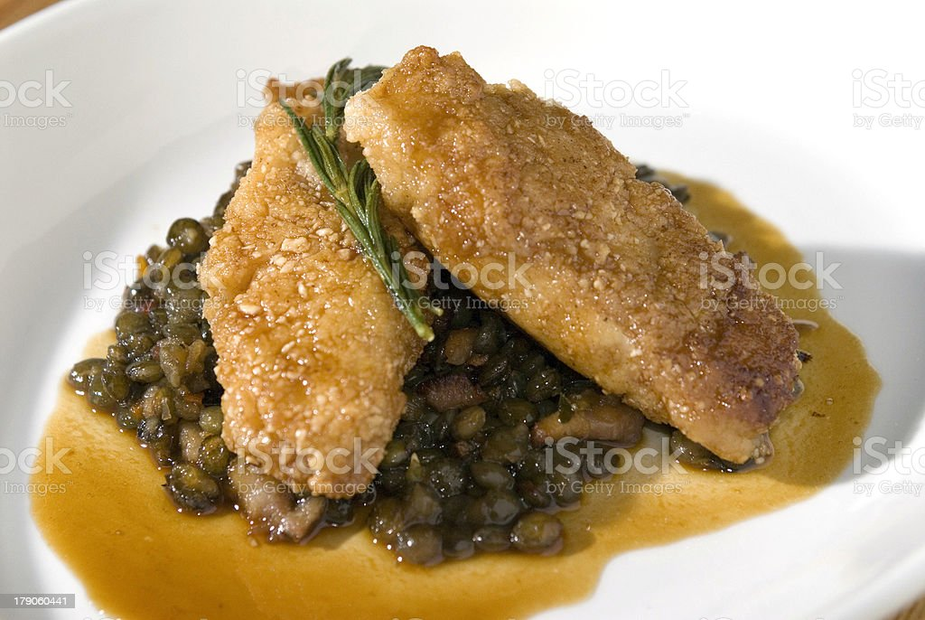Sweetbreads over lentils 3 stock photo