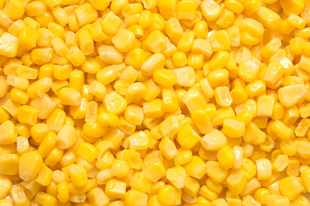 Sweetcorn Background Textured sweetcorn background. sweetcorn stock pictures, royalty-free photos & images