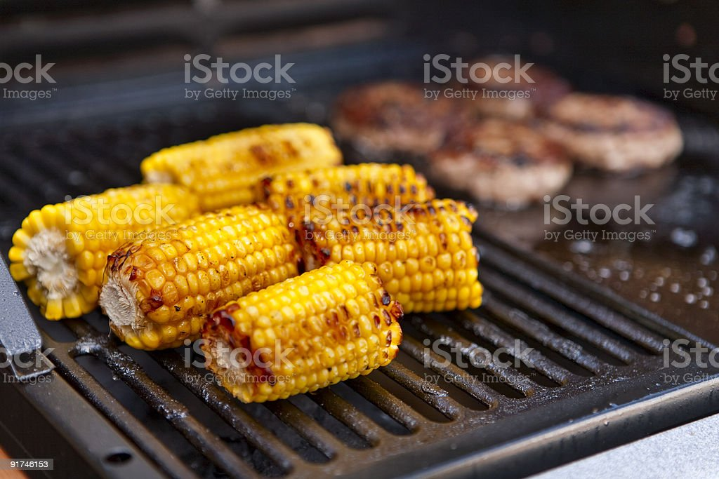 Sweetcorn cooking on a barbecue stock photo