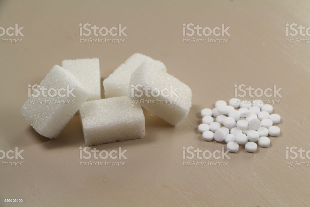 Sweetener tablets and sugar cubes stock photo