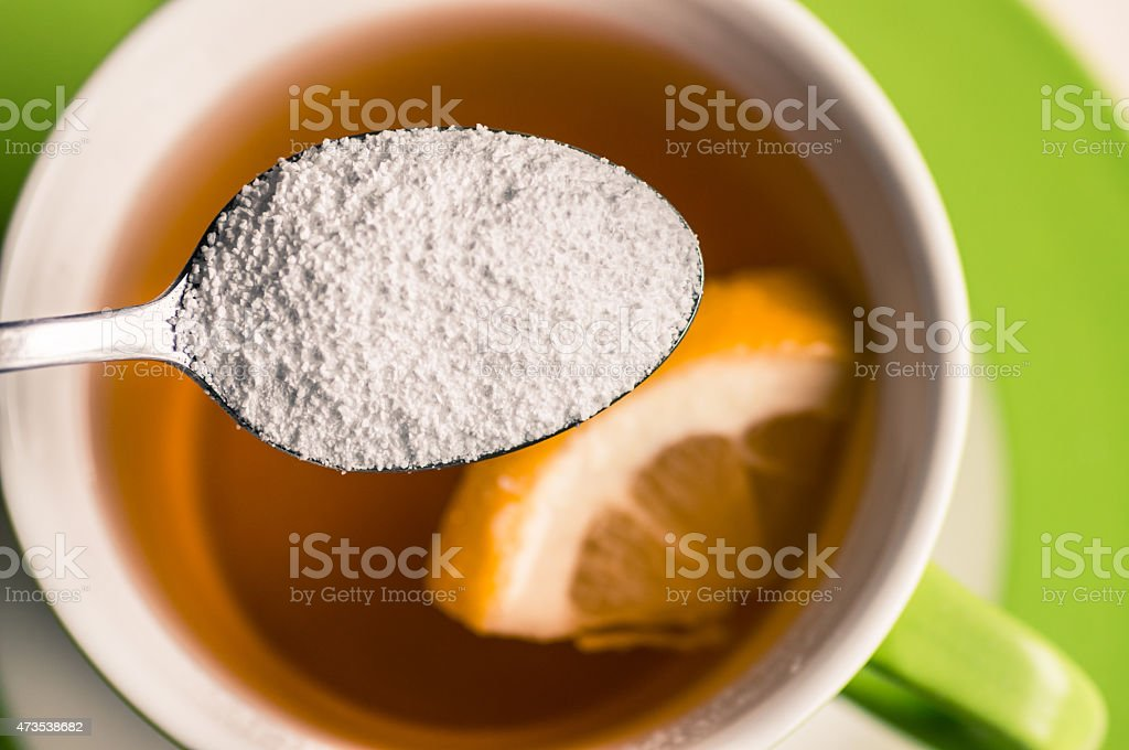 Sweeteners in the spoon top view stock photo