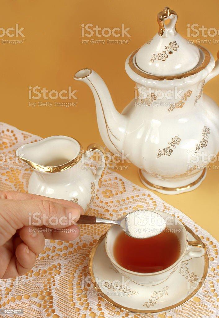 sweetening tea royalty-free stock photo