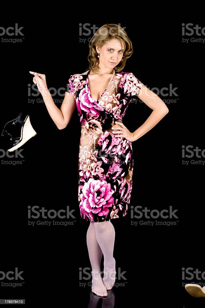 Sweet-Faced Fashion Model in Colorful Spring Outfit Removing her Shoes. stock photo