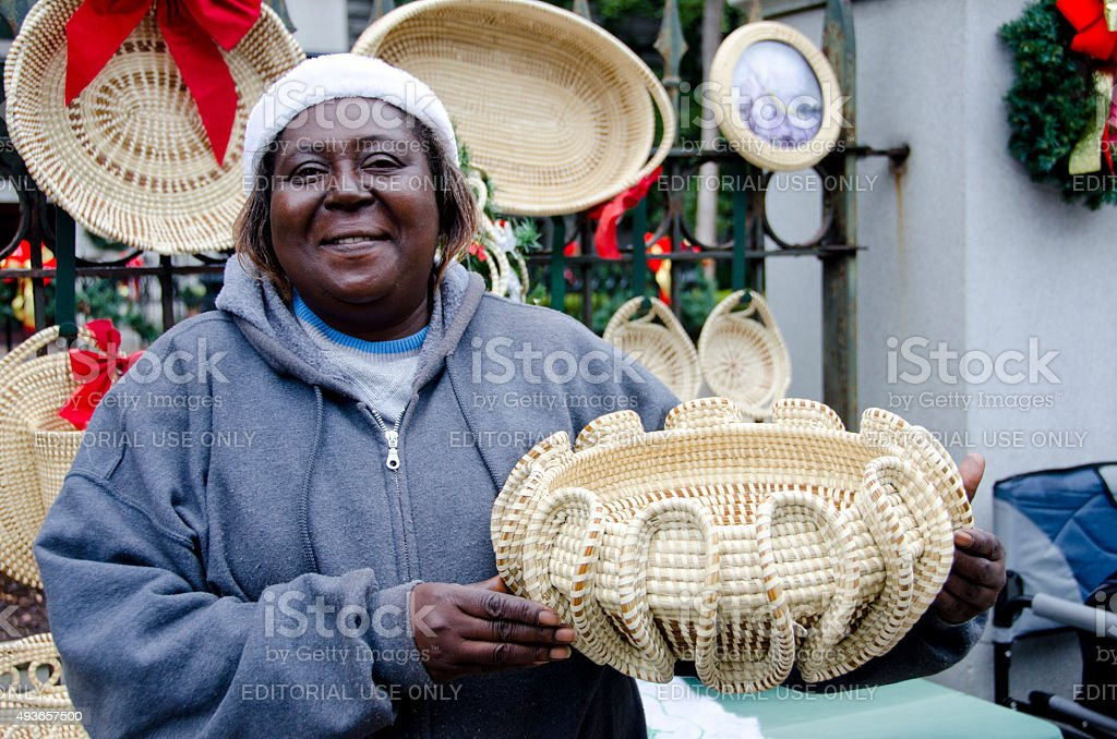 Sweetgrass Basket Maker on the Streets of Charleston stock photo