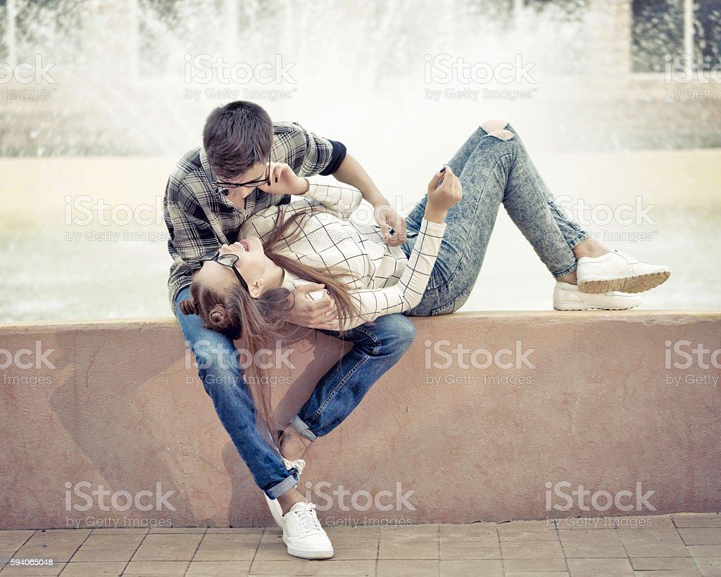 Sweethearts teenagers hug. stock photo