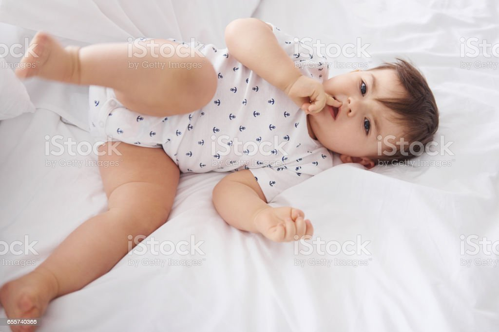 Sweetie baby  with finger on lips stock photo
