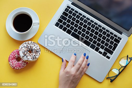 istock Sweeties and coffee makes your work nicer 636094960