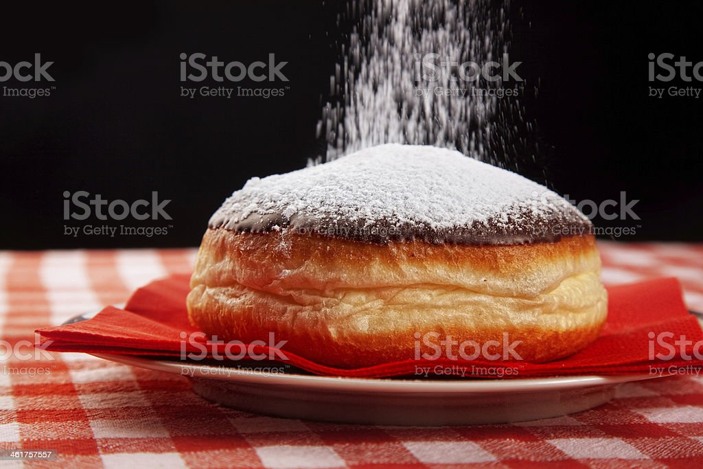 sweeting donut with powdered sugar stock photo