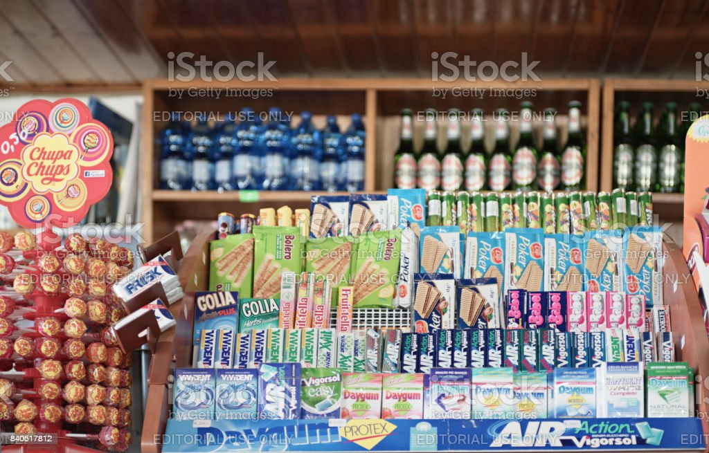 sweets and chewing gums for sale on the counter stock photo